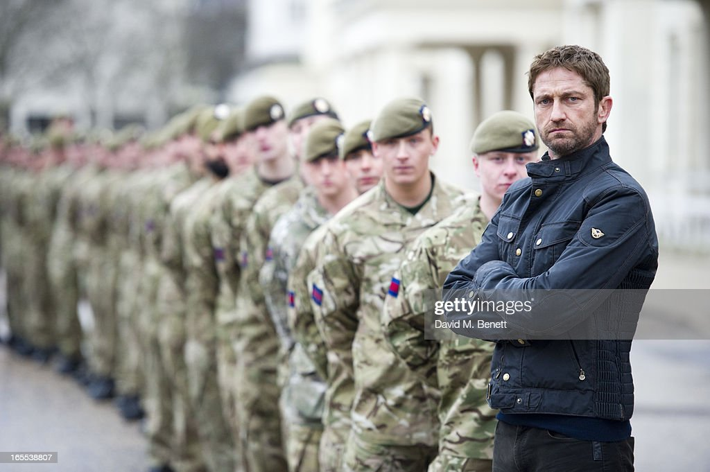Gerard Butler poses with troops ahead of a special preview screening of Olympus Has Fallen, released in cinemas on April 17, at Wellington Barracks on April 4, 2013 in London, England.