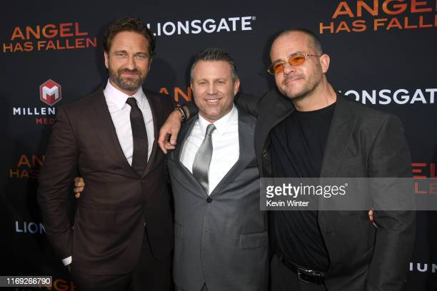 Gerard Butler Ric Roman Waugh and guest attend the LA Premiere of Lionsgate's Angel Has Fallen at Regency Village Theatre on August 20 2019 in...