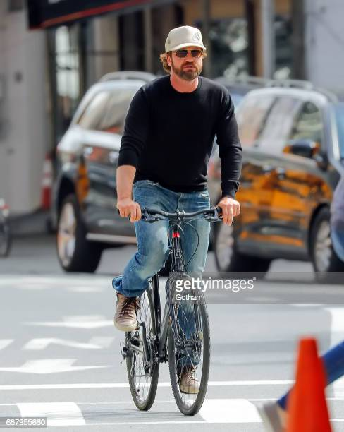 Gerard Butler rides a bike in Soho on May 24 2017 in New York City