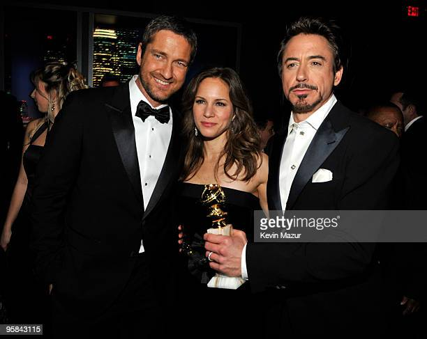 Gerard Butler Susan Downey and Robert Downey Jr attends the InStyle and Warner Bros 67th Annual Golden Globes postparty held at the Oasis Courtyard...