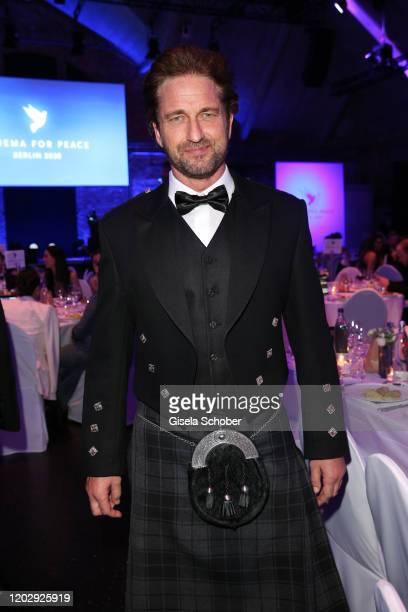 Gerard Butler wearing a kilt during the Cinema For Peace Gala at Westhafen Event Convention Center on February 23 2019 in Berlin Germany