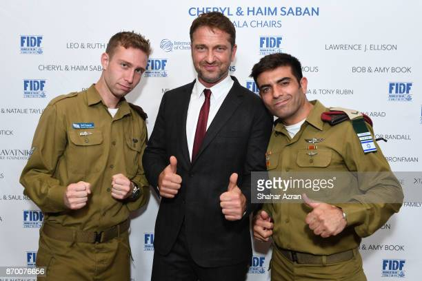 Gerard Butler with IDF Staff Sgt Nathan and IDF Staff Sgt Maor at the FIDF Western Region Gala at The Beverly Hilton Hotel on November 2 2017 in...