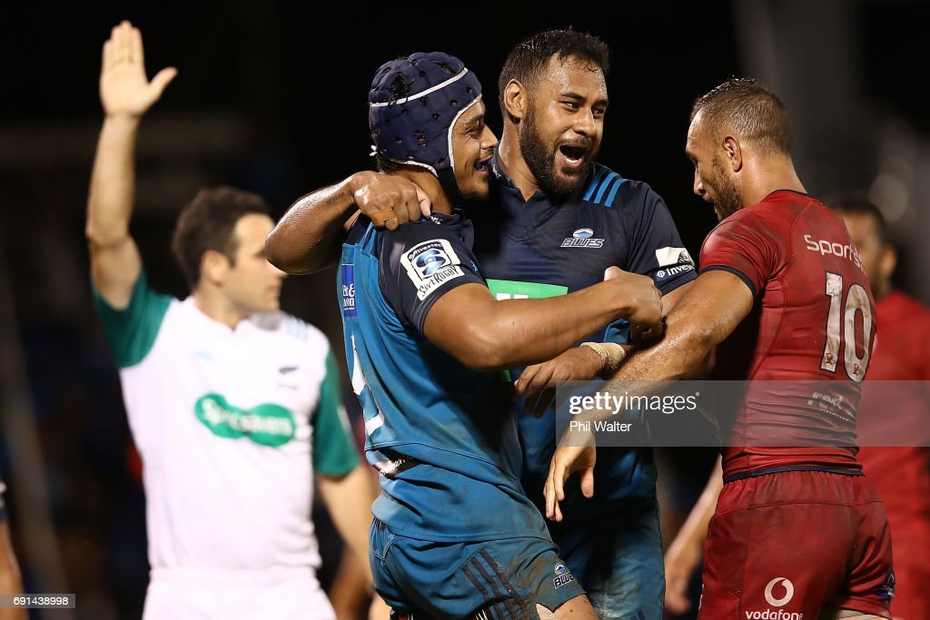 Gerard Cowley-Tuioti of the Blues (L) celebrates his try with Patrick Tuipulotu during the round 15 Super Rugby match between the Blues and the Reds at Apia Park National Stadium on June 2, 2017 in Apia, Samoa.