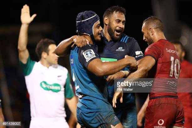 Gerard Cowley-Tuioti of the Blues celebrates his try with Patrick Tuipulotu during the round 15 Super Rugby match between the Blues and the Reds at...