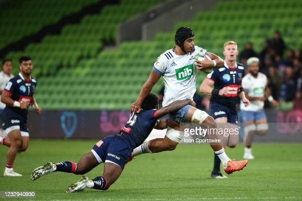 Gerard Cowley-Tuioti of the Blues gets tackled by Frank Lomani of the Melbourne Rebels during round one of the Super Rugby Trans Tasman match between...