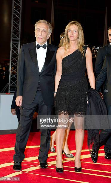 Gerard Darmon and girl friend attend the Marrakech International Film Festival 2011 Opening Ceremony on December 2 2011 in Marrakech Morocco