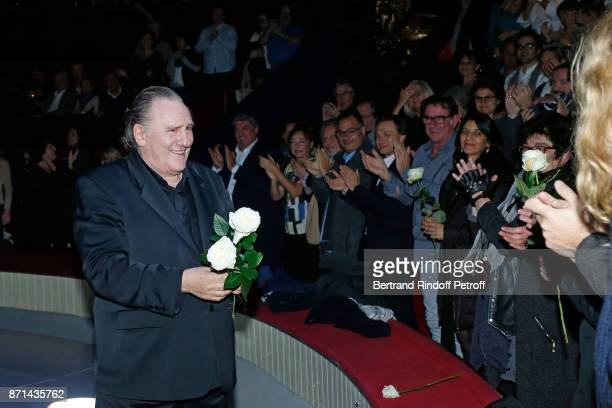 Gerard Depardieu acknowledges the applause of the audience and gives flowers at the end of 'Depardieu Chante Barbara' at Le Cirque d'Hiver on...