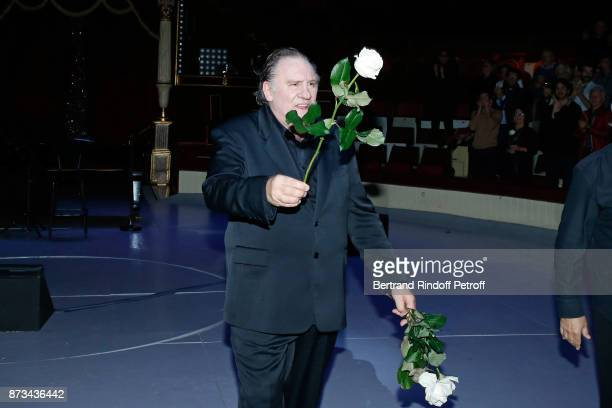 Gerard Depardieu acknowledges the applause of the audience and gives flowers to his fans at the end of attend 'Depardieu Chante Barbara' at 'Le...