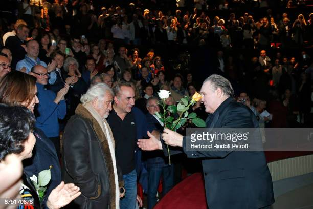 Gerard Depardieu acknowledges the applause of the audience and gives flowers to JeanPaul Belmondo and Antoine Dulery at the end of 'Depardieu Chante...