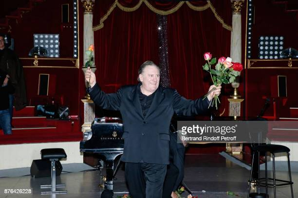Gerard Depardieu acknowledges the applause of the audience and gives flowers at the end of Barbara makes Gerard Depardieu triumph in Depardieu Chante...