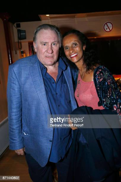Gerard Depardieu and Carine Silla pose after 'Depardieu Chante Barbara' at Le Cirque d'Hiver on November 6 2017 in Paris France