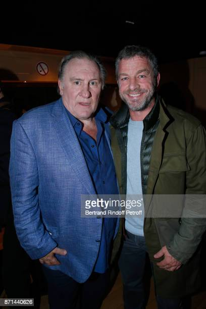 Gerard Depardieu and CEO of Courreges Jacques Bungert pose after 'Depardieu Chante Barbara' at Le Cirque d'Hiver on November 6 2017 in Paris France