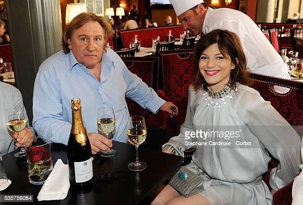 Gerard Depardieu and his girlfriend Clementine Igou promote the actor's Brut Princess Depardieu wine at the Majestic Hotel during the 62nd Cannes...