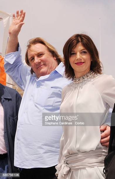 Gerard Depardieu and his girlfriend Clementine Igou promote the actor's Brut Princess Depardieu wine during the 62nd Cannes Film Festival