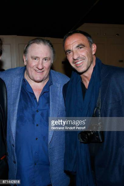 Gerard Depardieu and Nikos Aliagas pose after 'Depardieu Chante Barbara' at Le Cirque d'Hiver on November 6 2017 in Paris France