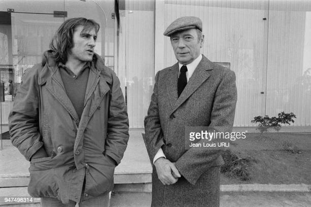 """Gerard Depardieu and Yves Montand on the set of """"Le choix des armes"""" directed by Alain Corneau."""