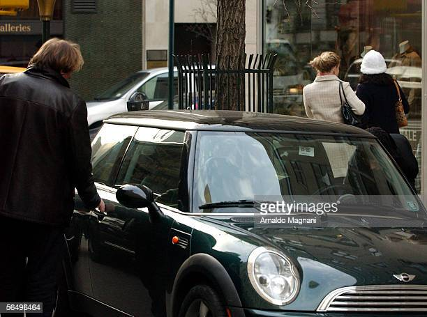 Gerard Depardieu gets into a car with Clementine Igou on December 28 2005 in New York City