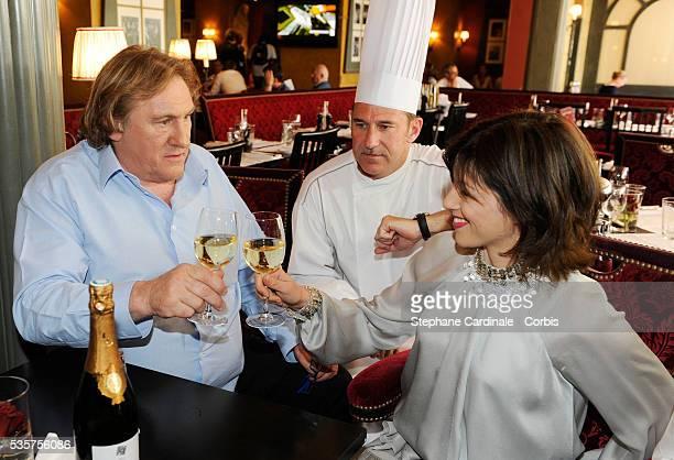 Gerard Depardieu his girlfriend Clementine Igou and Bertrand Schmitt promote the actor's Brut Princess Depardieu wine during the 62nd Cannes Film...