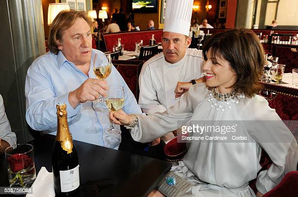 Gerard Depardieu his girlfriend Clementine Igou and Bertrand Schmitt promote the actor's Brut Princess Depardieu wine during the 62nd Cannes Film...