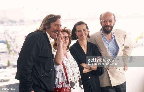 Gerard Depardieu Josiane Balasko Carole Bouquet and Bertrand Blier pose for a photocall of the movie 'Trop belle pour toi'