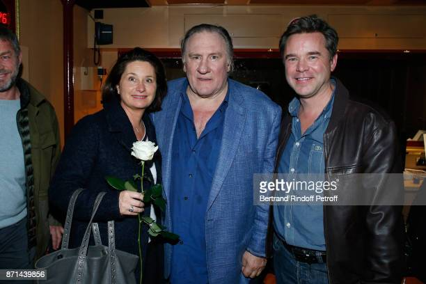Gerard Depardieu standing between Guillaume de Tonquedec and his wife Christelle pose after 'Depardieu Chante Barbara' at Le Cirque d'Hiver on...