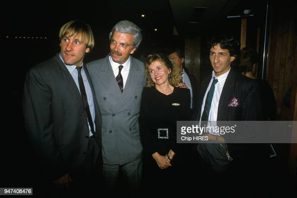 Gerard Depardieu with wife Elisabeth DanielToscan du Plantier and Richard Anconina at the premiere of the movie 'Police' directed by Maurice Pialat...