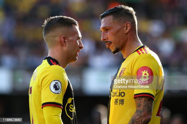 Gerard Deulofeu and Jose Holebas of Watford during the Premier League match between Watford FC and Arsenal FC at Vicarage Road on September 15 2019...