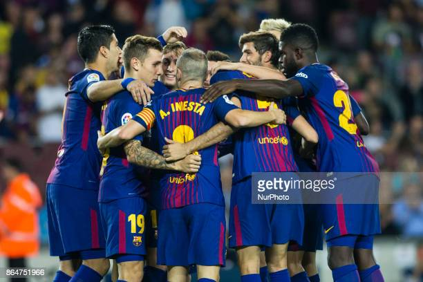 Gerard Deulofeu from Spain of FC Barcelona celebrating his goal with his team during the La Liga match between FC Barcelona v Malaga at Montilivi...