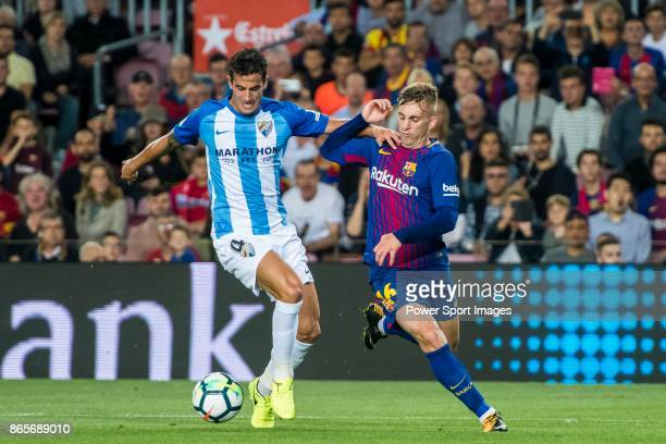 Gerard Deulofeu Lazaro of FC Barcelona battles for the ball with Luis Hernandez Rodriguez of Malaga CF during the La Liga 201718 match between FC...