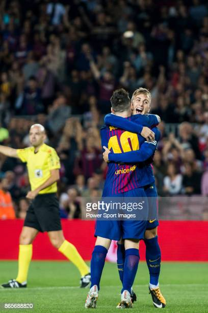Gerard Deulofeu Lazaro of FC Barcelona celebrates with teammate Lionel Andres Messi during the La Liga 201718 match between FC Barcelona and Malaga...