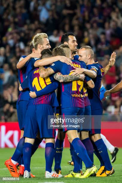 Gerard Deulofeu Lazaro of FC Barcelona celebrates with teammates during the La Liga 201718 match between FC Barcelona and Malaga CF at Camp Nou on 21...