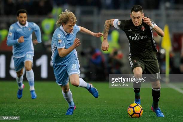 Gerard Deulofeu of Ac Milan compete for the ball with Dusan Basta of SS Lazio during the Serie A match between SS Lazio and AC Milan at Stadio...