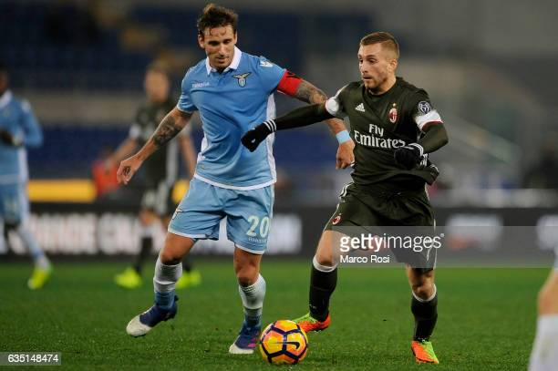 Gerard Deulofeu of AC Milan compete for the ball with Lucas Biglia of SS Lazio during the Serie A match between SS Lazio and AC Milan at Stadio...