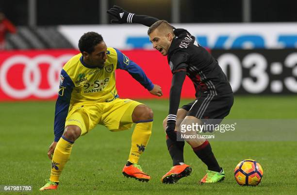 Gerard Deulofeu of AC Milan is challenged by Jonathan De Guzman of AC ChievoVerona during the Serie A match between AC Milan and AC ChievoVerona at...