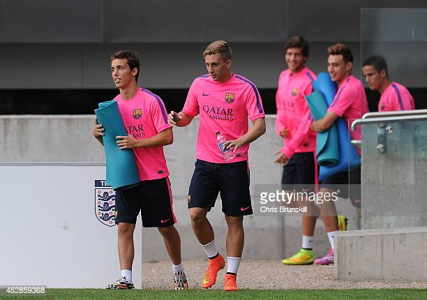 Gerard Deulofeu of Barcelona arrives ahead of the Barcelona Training Session at St George's Park on July 28 2014 in BurtonuponTrent England