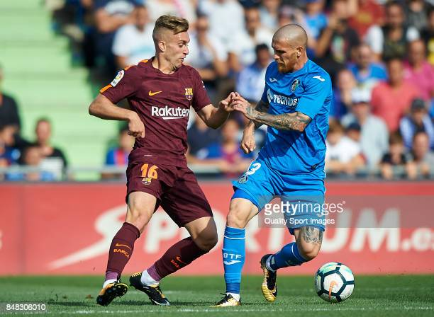 Gerard Deulofeu of Barcelona competes for the ball with Vitorino Antunes of Getafe during the La Liga match between Getafe and Barcelona at Coliseum...