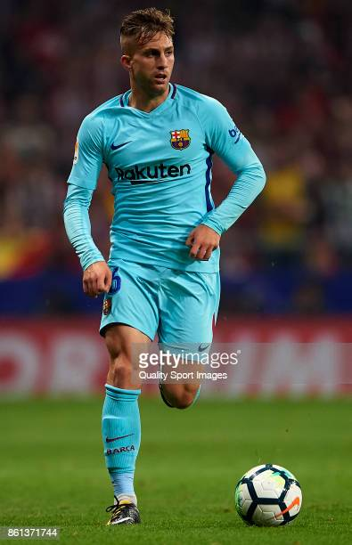 Gerard Deulofeu of Barcelona runs with the ball during the La Liga match between Atletico Madrid and Barcelona at Estadio Wanda Metropolitano on...