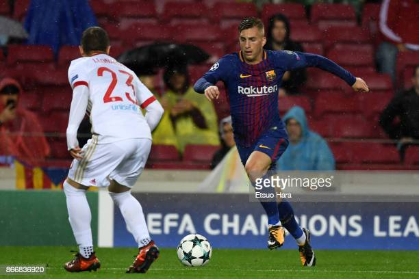 Gerard Deulofeu of Barcelona takes on Leonardo Koutris of Olympicakos during the UEFA Champions League group D match between FC Barcelona and...
