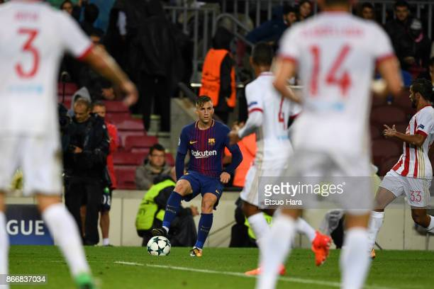Gerard Deulofeu of Barcelona takes on Olympiakos defense during the UEFA Champions League group D match between FC Barcelona and Olympiakos Piraeus...