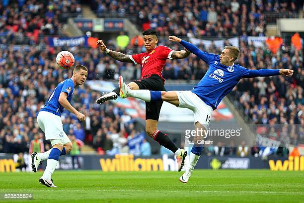 Gerard Deulofeu of Everton and Marcos Rojo of Manchester United battle for the ball during The Emirates FA Cup semi final match between Everton and...