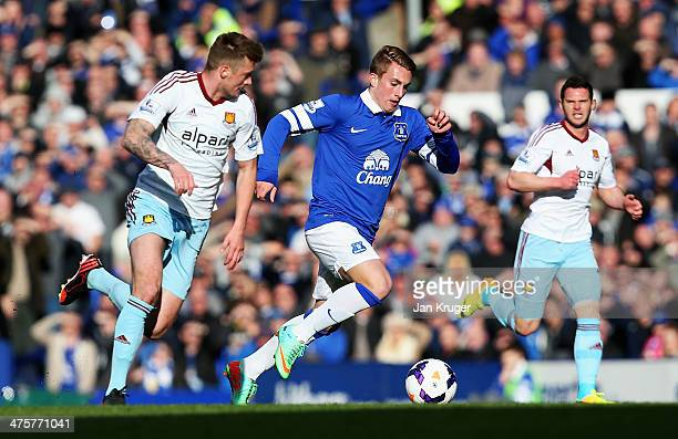 Gerard Deulofeu of Everton breaks past George McCartney of West Ham United during the Barclays Premier League match between Everton and West Ham...