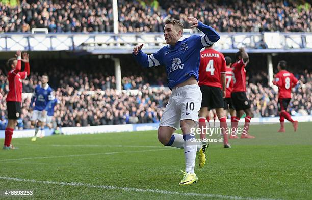 Gerard Deulofeu of Everton celebrates after scoring the first goal during the Barclays Premier League match between Everton and Cardiff City at...