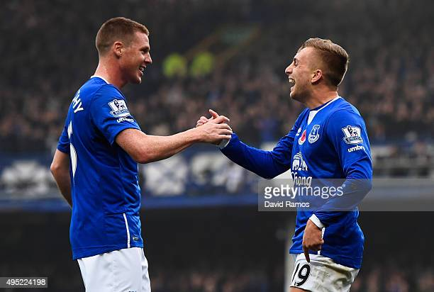 Gerard Deulofeu of Everton celebrates with James McCarthy as he scores their first goal during the Barclays Premier League match between Everton and...