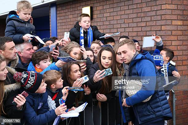 Gerard Deulofeu of Everton poses for a selfie photograph as he arrives prior to the Barclays Premier League match between Everton and Stoke City at...