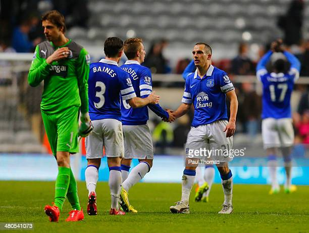 Gerard Deulofeu of Everton shakes hands with Leon Osman of Everton at the final whistle during the Barclays Premier League match between Newcastle...