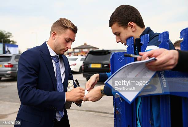Gerard Deulofeu of Everton signs autographs with a fan prior to the Barclays Premier League match between Everton and Manchester City on August 23...