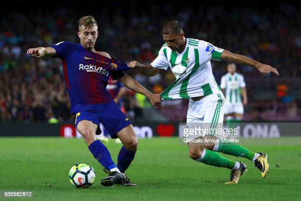 Gerard Deulofeu of FC Barcelona competes for the ball with Joaquin Sanchez of Real Betis Balompie during the La Liga match between FC Barcelona and...