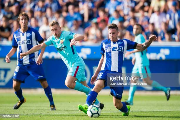 Gerard Deulofeu of FC Barcelona duels for the ball with Carlos Vigaray of Deportivo Alaves during the La Liga match between Deportivo Alaves and...