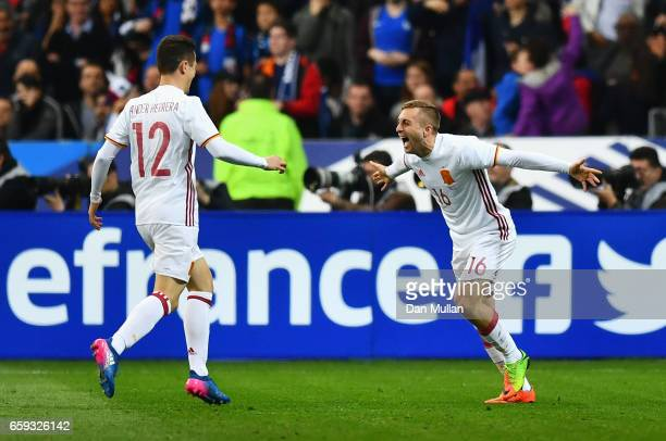 Gerard Deulofeu of Spain celebrates scoring his team's second goal with Ander Herrera during the International Friendly match between France and...