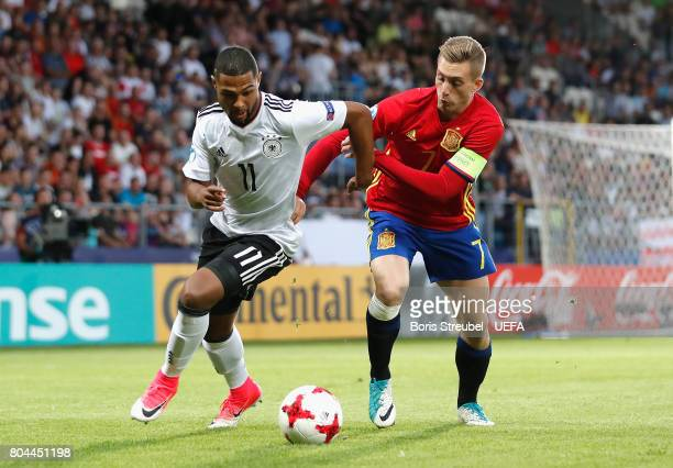 Gerard Deulofeu of Spain chases Serge Gnabry of Germany during the UEFA European Under21 Championship Final between Germany and Spain at Krakow...